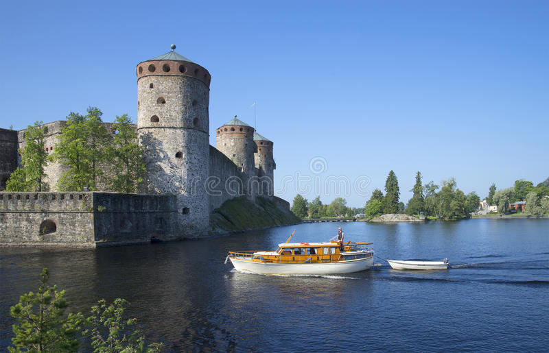 Summer day at the fortress of Savonlinna. Finland. SAVONLINNA, FINLAND - AUGUST 03, 2013: Summer day at the fortress of Savonlinna. Historical landmark of the stock photography