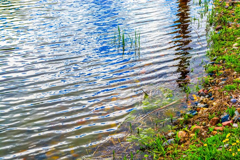 Beautiful lake. Clouds are reflected in the lake. royalty free stock image