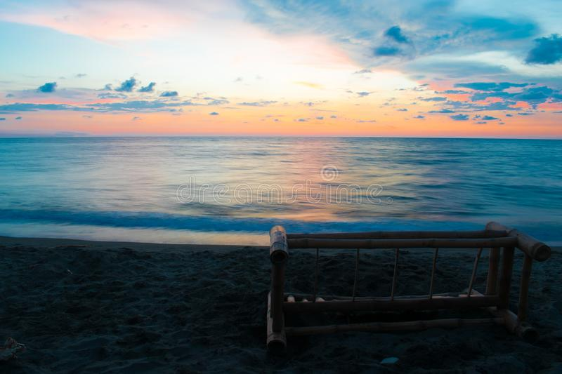 Summer Day Ocean Sunset Long Exposure Background Image. Ideal as a background page or text page for projects, this long-exposure image depicts a summer ocean stock photos