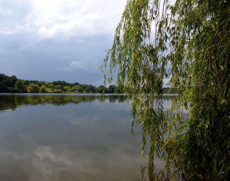 Summer day before a thunderstorm. Summer day by the lake. Thunderstorm approachi royalty free stock image