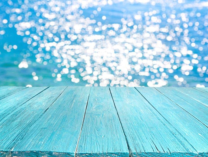 Summer desk table. Against the sunny sea stock photos