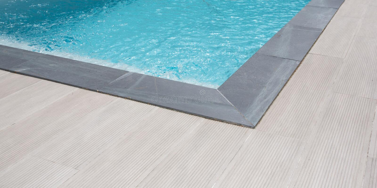 Summer detail corner swimming pool in sunny weather in web template banner royalty free stock photo