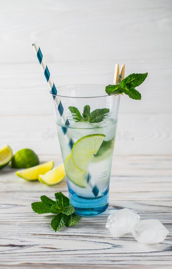 Summer detox healthy organic refreshing water with lemon, lime and mint royalty free stock images