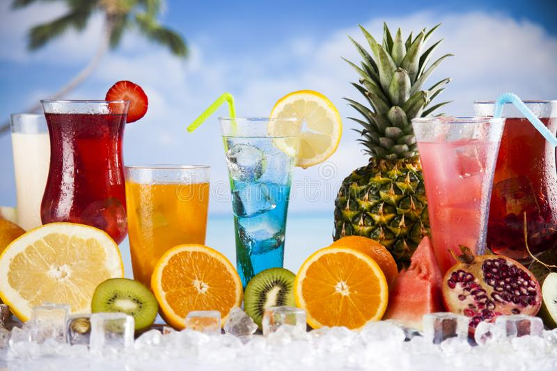 Summer drink, palm branch and Fresh tropical fruits stock photo