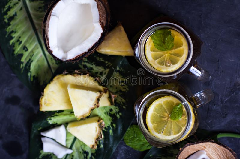 Summer drink, ice tea, cocktail, smoothies with tropical fruits royalty free stock image