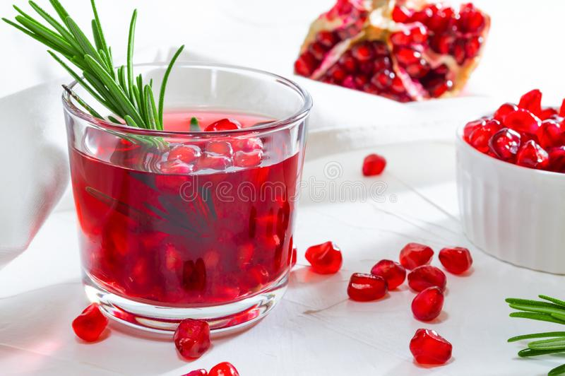 Summer drink with pomegranate and rosemary. White background royalty free stock photo