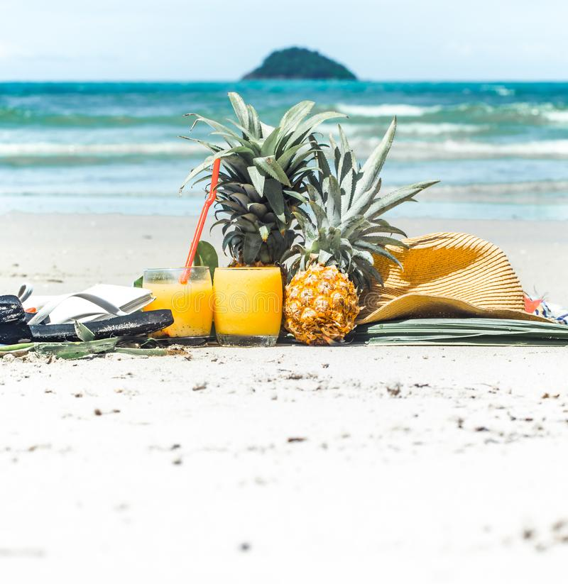 Summer drinks with fruit on the beach, exotic still life stock photography