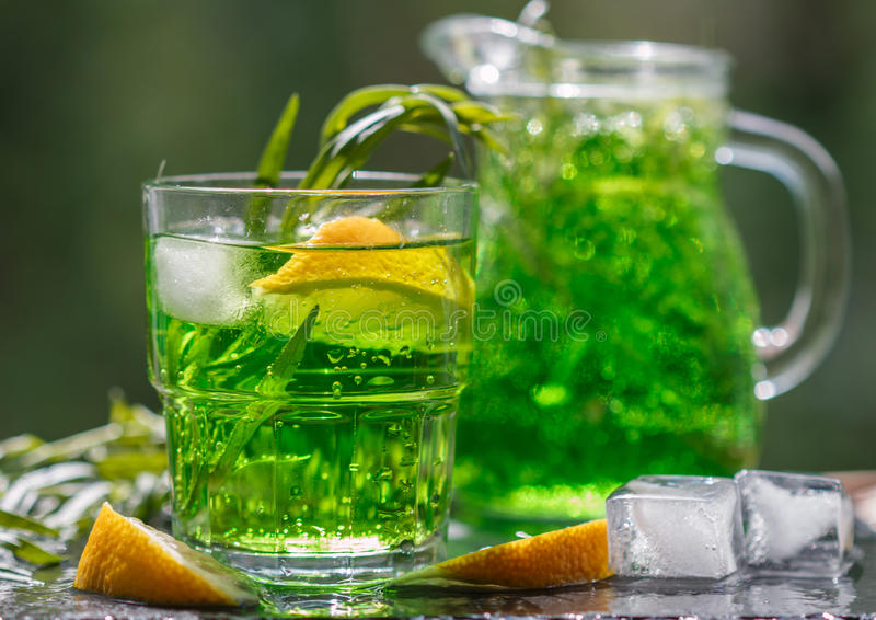 Summer drinks. Refreshing lemonade from lemons, mint and tarragon stock image