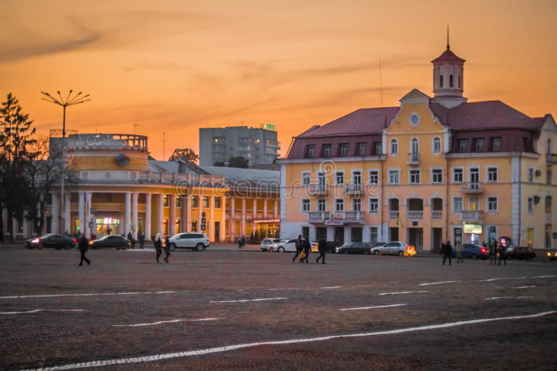 Summer or early autumn square of ukrainian town at sunset. Long shadows, soft light and low sun. Chernihiv, Ukraine royalty free stock photo