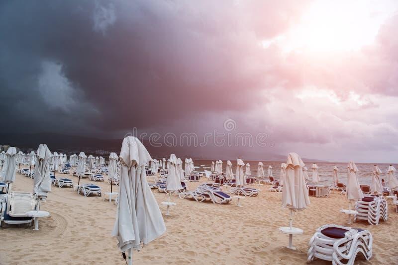 Summer empty beach before the rain with sunlight.  stock photo