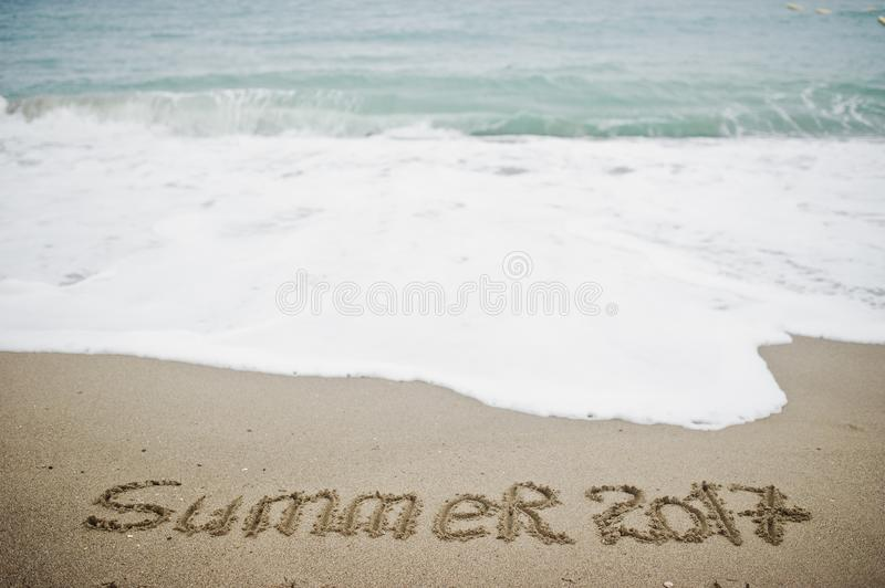 Download Summer 2017 End. New Year 2018 Is Coming Concept. Sea And Sand.