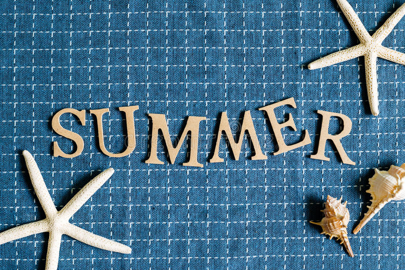 Summer english alphabet on check pattern cloth background royalty free stock photo