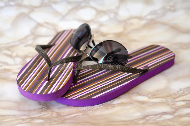 Summer equipment. Colorful fashion sandals and sunglasses summer concept royalty free stock photo
