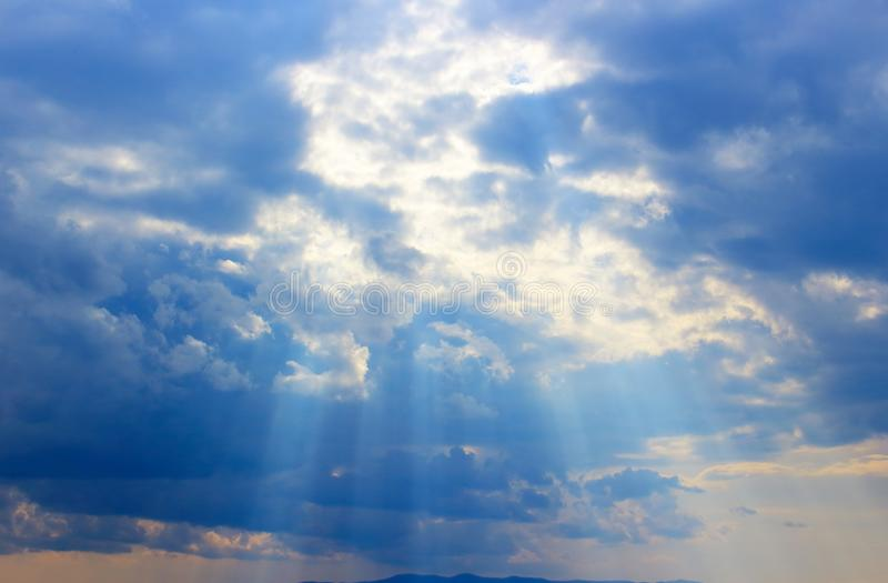 Summer evening landscape with bright sun rays. royalty free stock photography