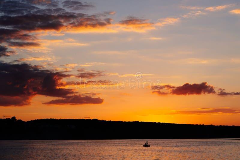 Sunset on the lake. Summer evening. Scenic landscape. Sunset on the lake stock image