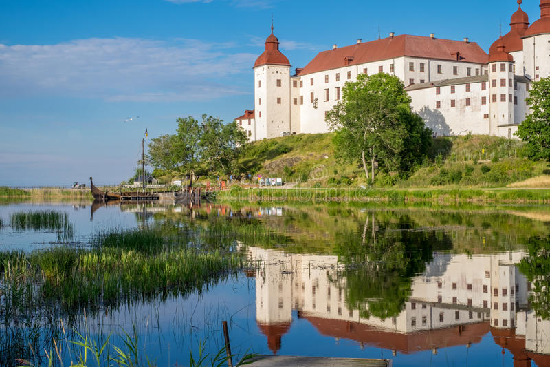 Summer evening in Sweden. Lidkoping, Sweden - July 23, 2016: Summer evening by Lake Vanern and Lacko Castle. Lacko castle dating back to the 13th century has royalty free stock images