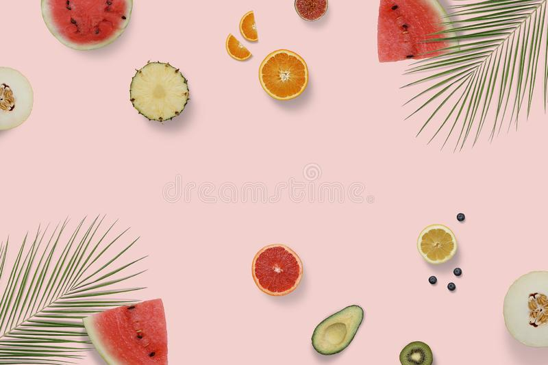 Summer exotic fruit top view flatlay with green palm leaves. Sliced watermelon stock photos