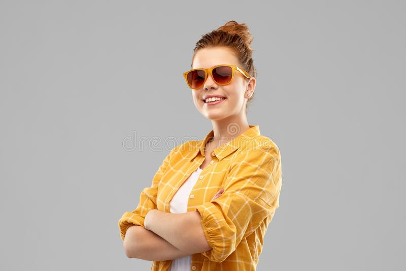 Smiling red haired teenage girl in sunglasses royalty free stock photos