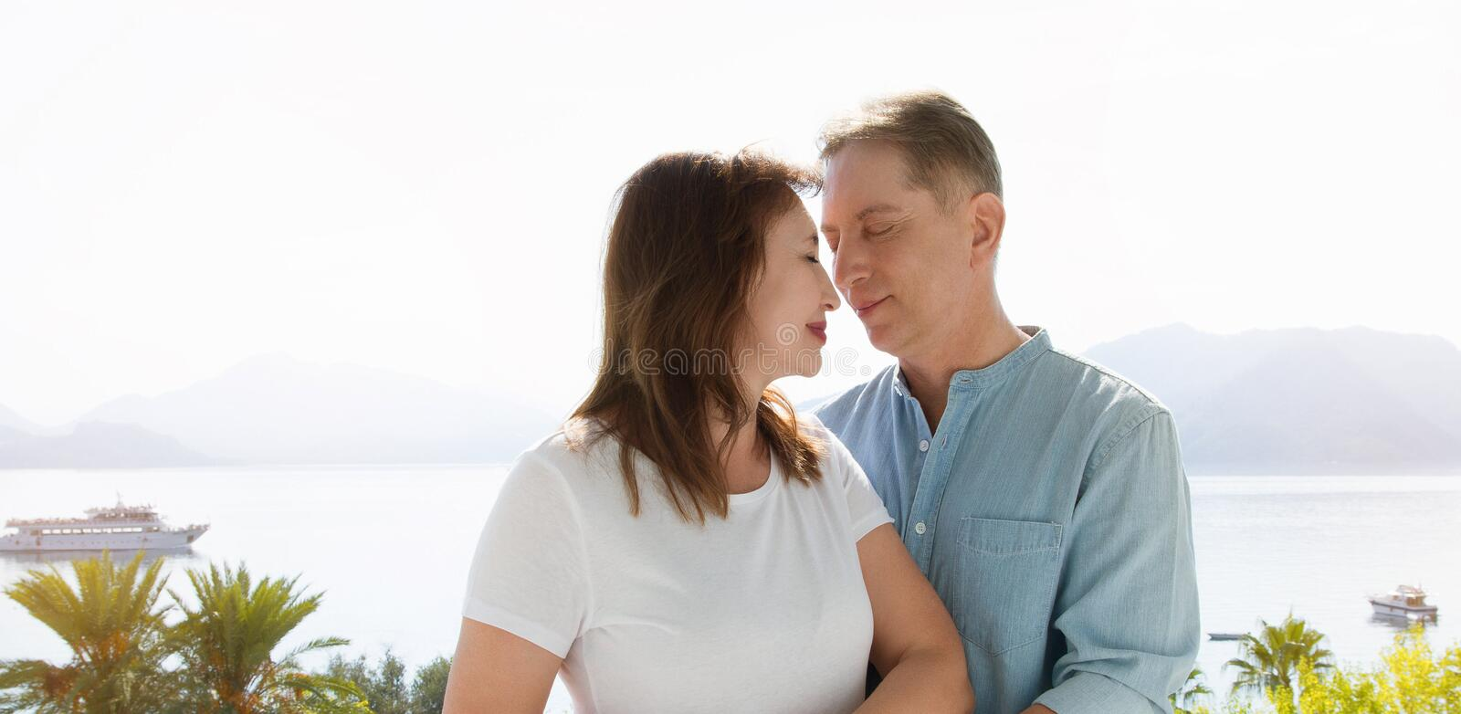 Summer family vacation. Happy middle aged couple having fun on travel holidays weekend. Sea and beach background. Copy space stock images