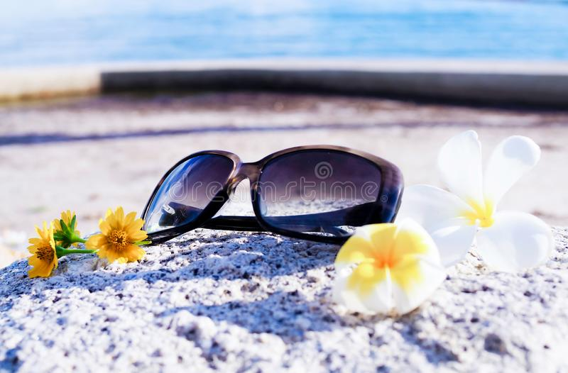 Summer fashion beach sunglasses Relaxing day at the sea royalty free stock images