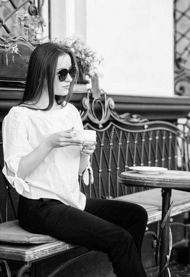 Summer fashion beauty. Meeting in cafe. girl relax in cafe. Business lunch. stylish woman in glasses drink coffee. good. Morning. Breakfast time. morning coffee royalty free stock images
