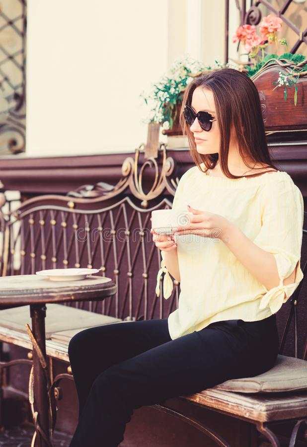 Summer fashion beauty. Meeting in cafe. girl relax in cafe. Business lunch. stylish woman in glasses drink coffee. good stock photography