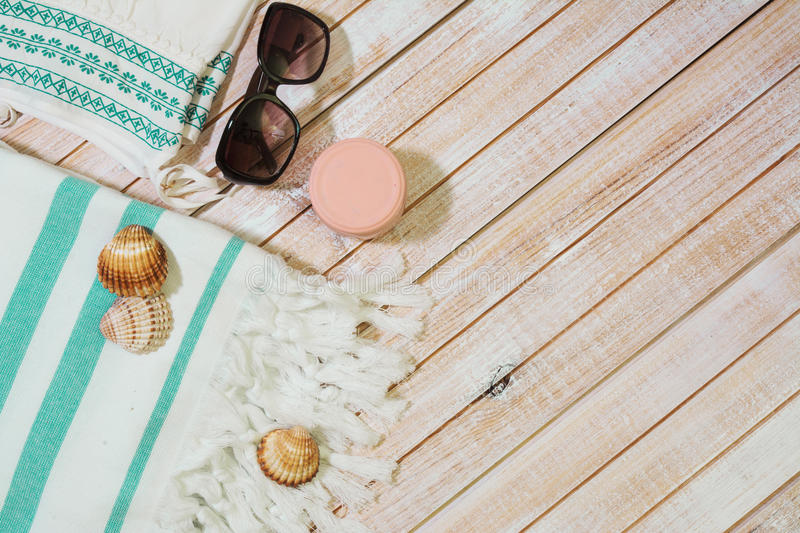 Summer Fashion girl clothes set. collection for the beach on woo. Den background, copy space royalty free stock photos