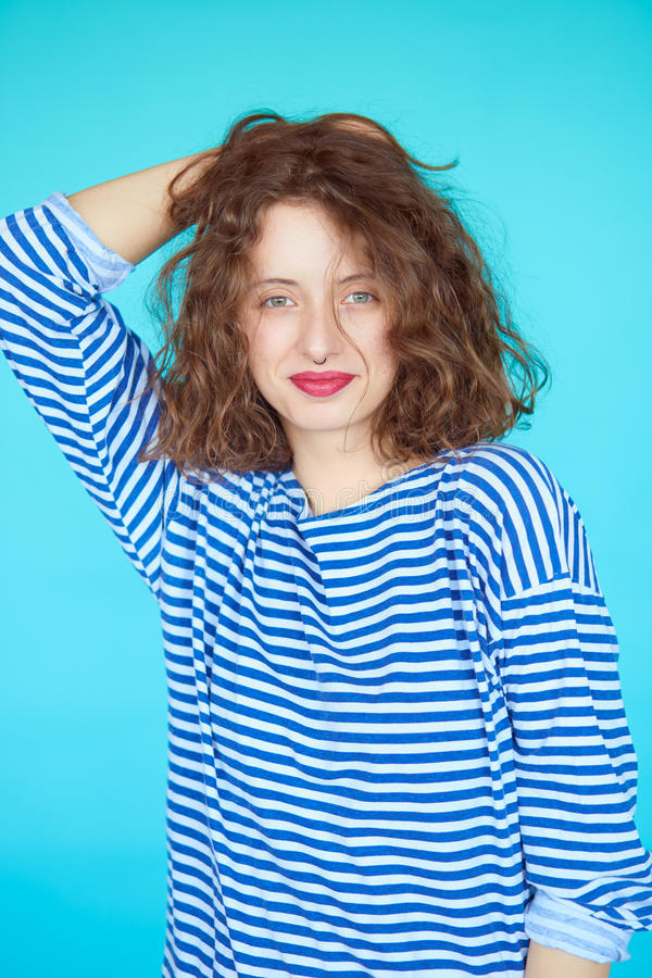 Summer fashion girl with curly hairstyle and striped shirt royalty free stock photography