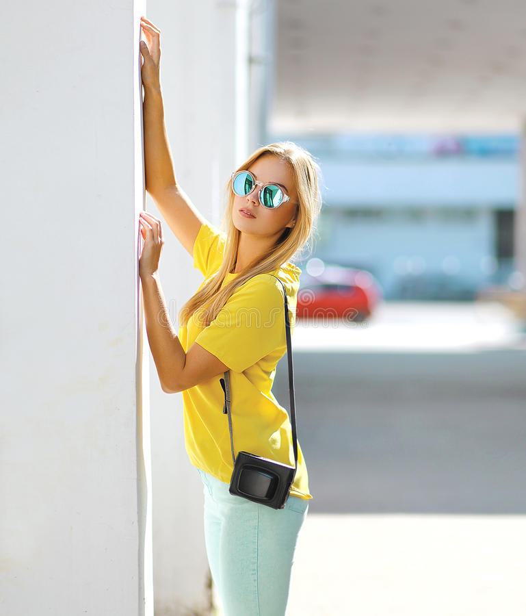 Summer, fashion and people concept - bright stylish woman. Summer, fashion and people concept - bright stylish portrait pretty woman in sunglasses posing in stock photo