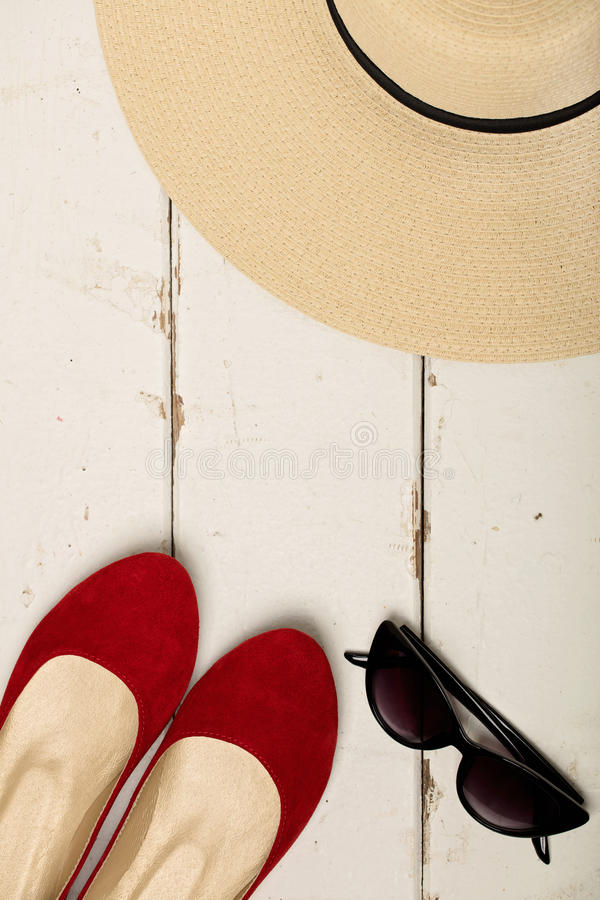 Summer fashion set. Women`s hat, ballet flats and sunglasses. stock image
