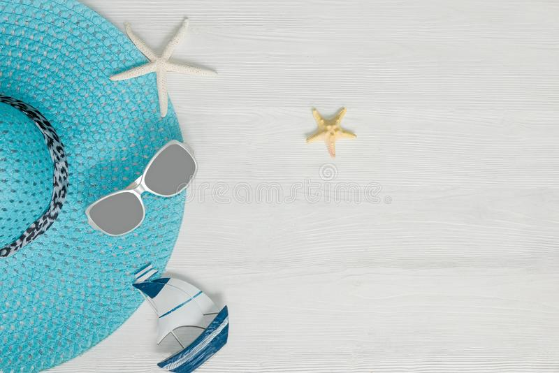 Summer Fashion woman blue big hat. Tropical sea. Unusual top view, white background. Summer Concept royalty free stock photos