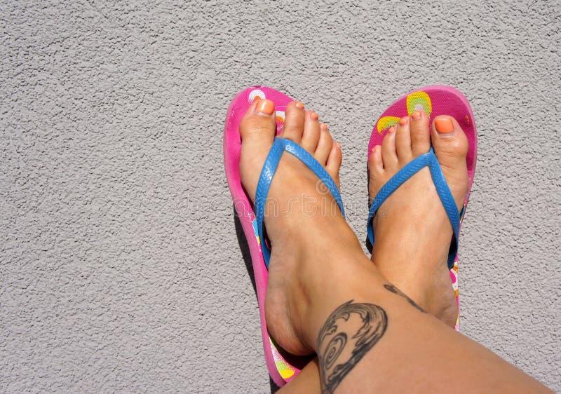Summer feet with flip flops stock image