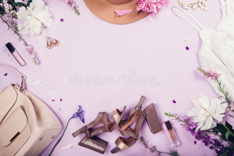 Summer female outfit. Set of clothes, shoes, cosmetics and accessories with fresh flowers. Beauty fashion concept. Copy space royalty free stock photos