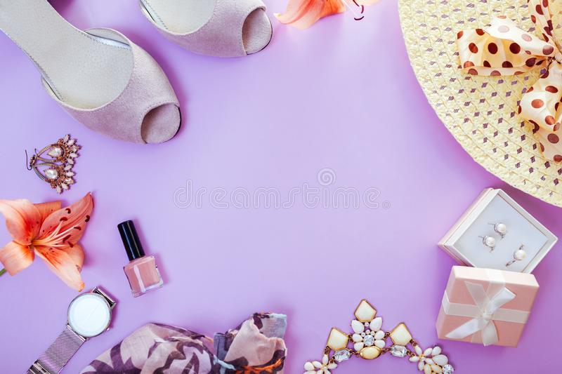 Summer female outfit. Set of clothes, shoes, cosmetics and accessories with fresh flowers. Trendy jewellery. Summer female outfit. Set of clothes, shoes stock images