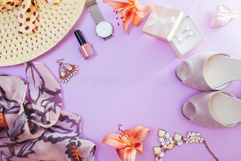 Summer female outfit. Set of clothes, shoes, cosmetics and accessories with fresh flowers. Trendy jewellery. Summer female outfit. Set of clothes, shoes stock photography