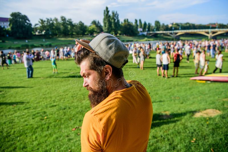 Summer fest. Man bearded hipster in front of crowd. Book ticket now. Open air concert. City day. Music festival royalty free stock photo