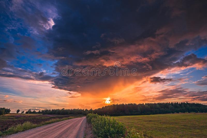 Summer field with path and sunset sky above. Beautiful sunset landscape. Lithuania royalty free stock photo