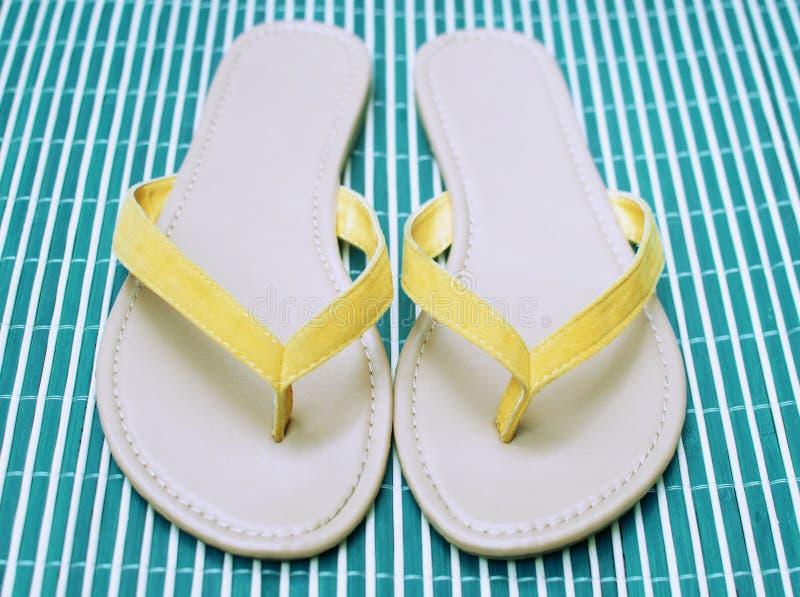 Summer flip flops. Yellow summer flip flops sandals stock images