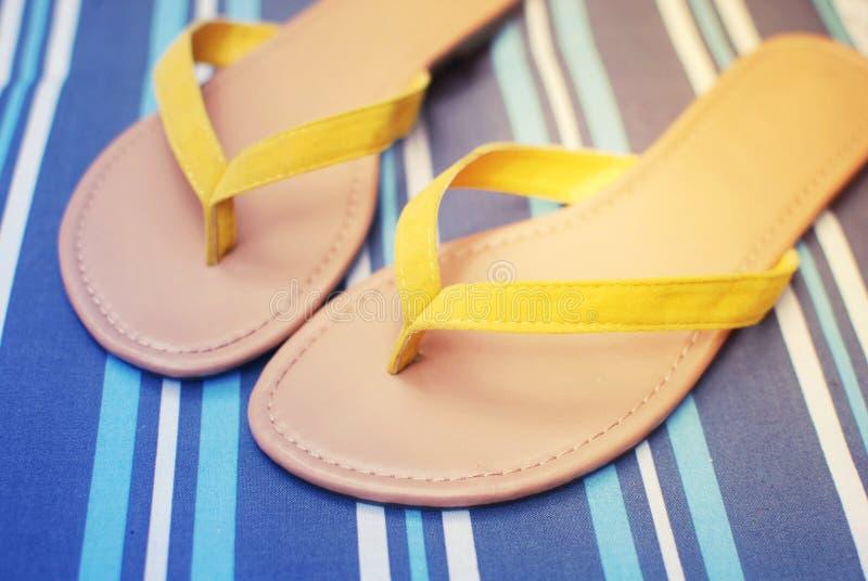 Summer flip flops. Yellow summer flip flops sandals royalty free stock images