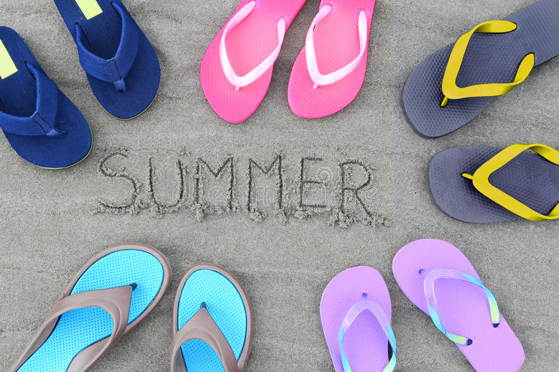Summer flip flops. On the beach royalty free stock photo