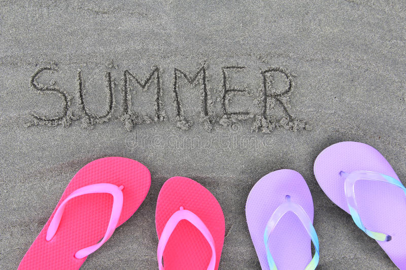 Summer flip flops. On the beach stock photography