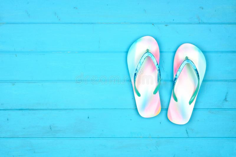 Summer flip flops on a blue wood background, top view with copy space. Summer flip flops on a blue wood background. Summer vacation concept. Top view with copy royalty free stock photography