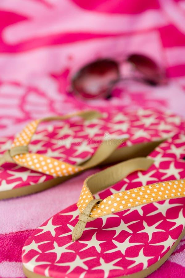 Summer - flip flops, sunglasses & towel royalty free stock photos