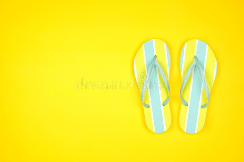 Summer flip flops on a yellow background, top view with copy space. Summer flip flops on a yellow background. Summer vacation concept. Top view with copy space stock image
