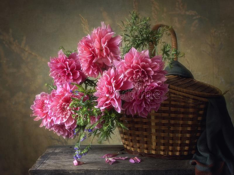 Summer floral still life with beautiful bouquet dahlias in a basket stock images