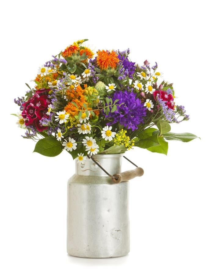 Summer flower bouquet in vintage milk churn stock photo
