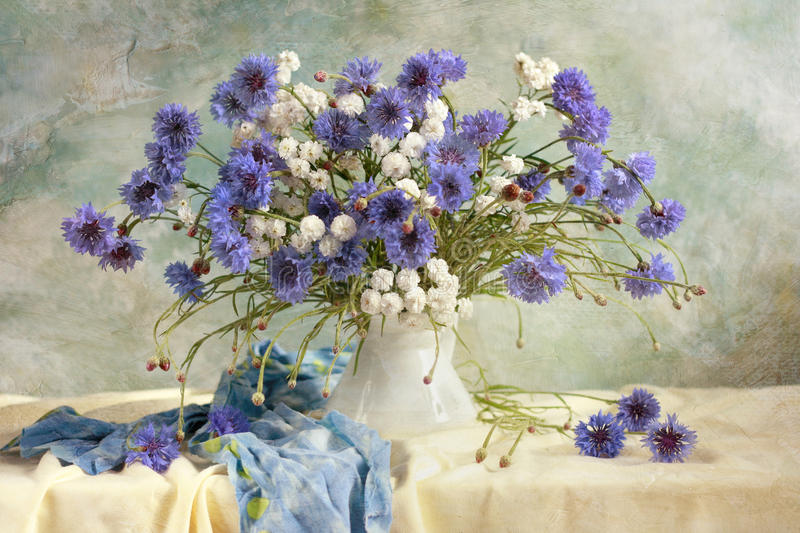 Summer flowers. Beautiful summer flowers bouquet with cornflowers royalty free stock image