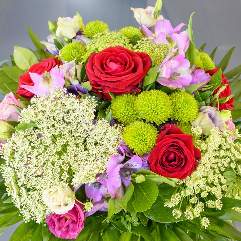 Summer flowers in arrangement, luxury bouquet with beautiful red roses, carrot umbel and sweetwilliams royalty free stock photos
