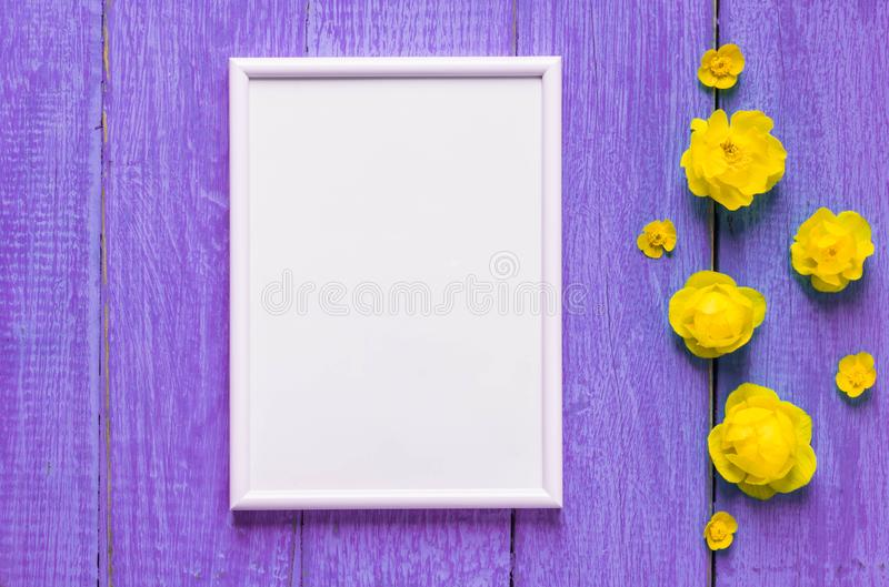 Summer flowers on an old purpur wooden background. Bright summer floral background with space for text. Colorful flower card royalty free stock image