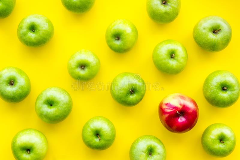 Summer food with apples on yellow background top view pattern. Summer food with green apples on yellow background top view pattern stock image